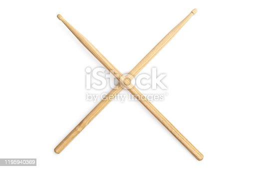 Drum sticks crossed on a white background.