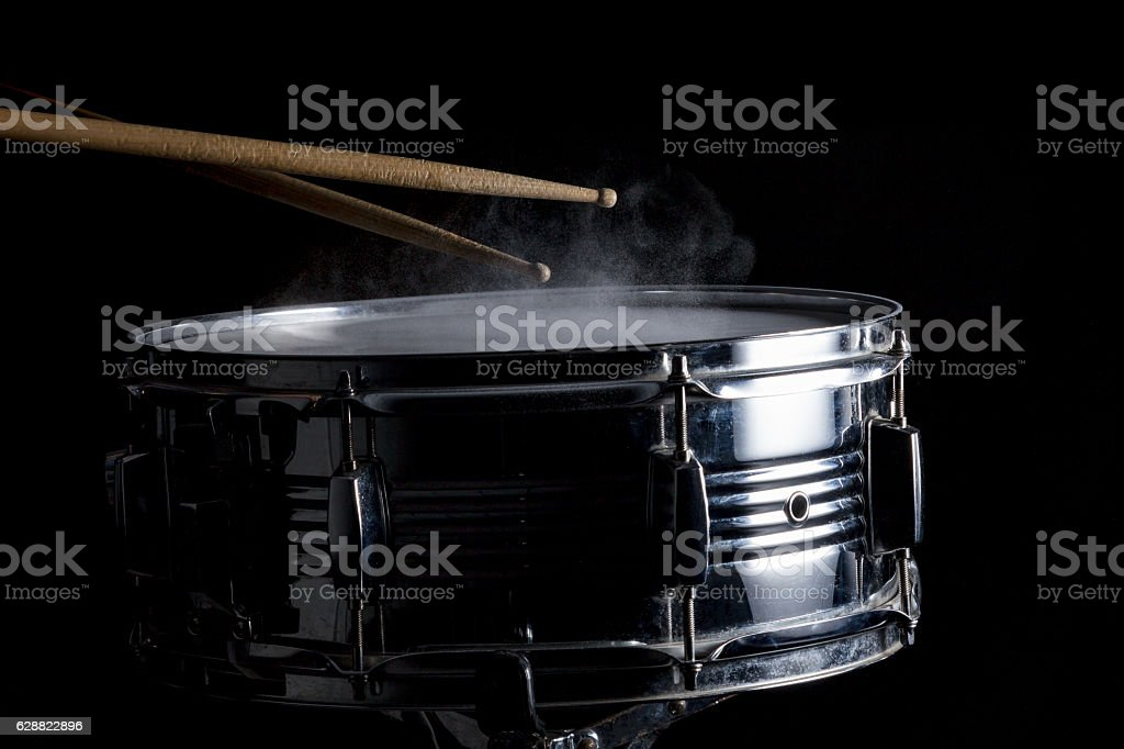 Drum sticks hit on the snare drum stock photo
