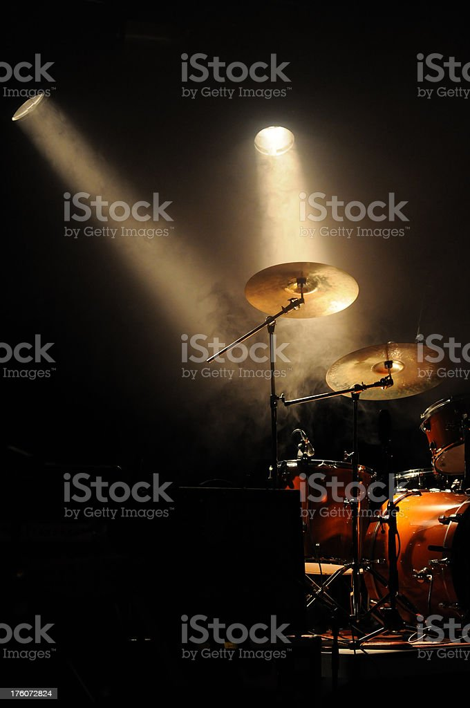 drumkit in smoke and spotlights royalty-free stock photo