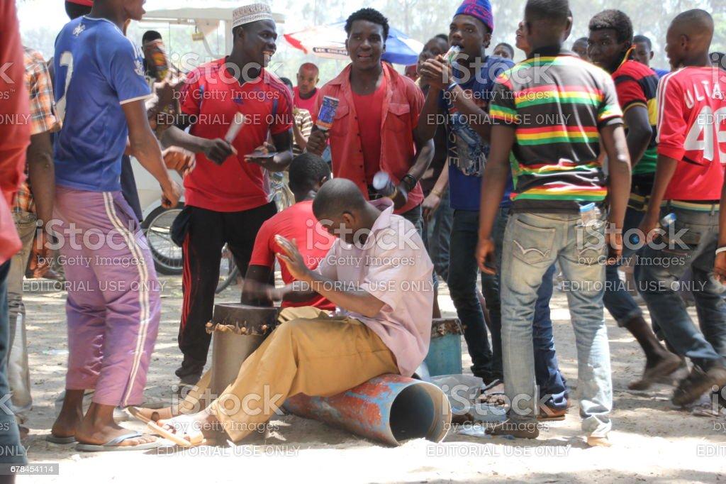 Drummer and Dancing People at Mapinduzi Road, Zanzibar City, Indian Ocean, East Africa royalty-free stock photo