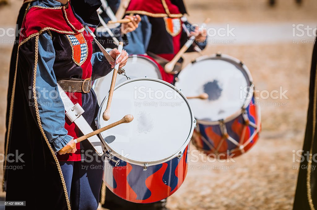 Drummer in medieval parade stock photo