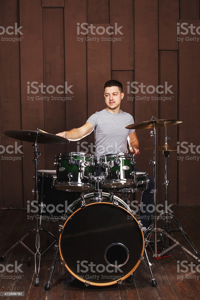 Drummer on a brown background stock photo