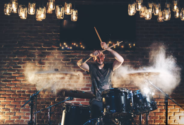 Drummer Performing in a bar Drummer performing in a bar at night drummer stock pictures, royalty-free photos & images