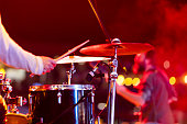 Drummer playing drums on stage