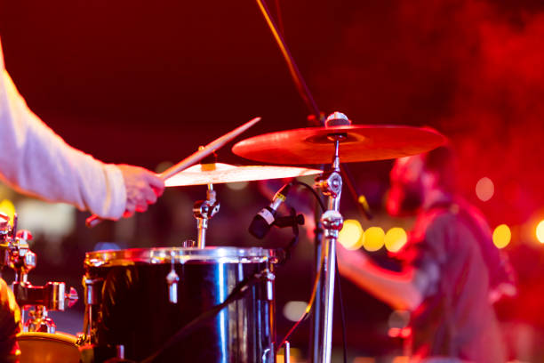 Drummer playing drums on stage Drummer playing drums on stage drummer stock pictures, royalty-free photos & images