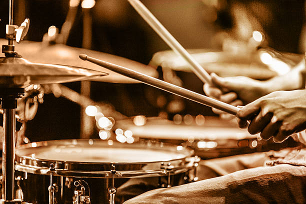 Drummer playing drums on stage view and shot from backstage: drummer playing hi hat and snare drum drummer stock pictures, royalty-free photos & images