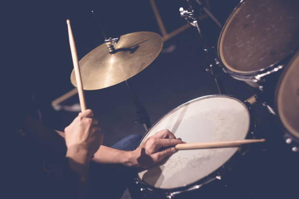 Drummer playing drums Close up of hands of male drummer holdning drumsticks sitting and playing drums in studio drummer stock pictures, royalty-free photos & images