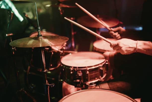 Drummer playing his drum kit on concert in club Drummer playing his drum kit on concert drummer stock pictures, royalty-free photos & images
