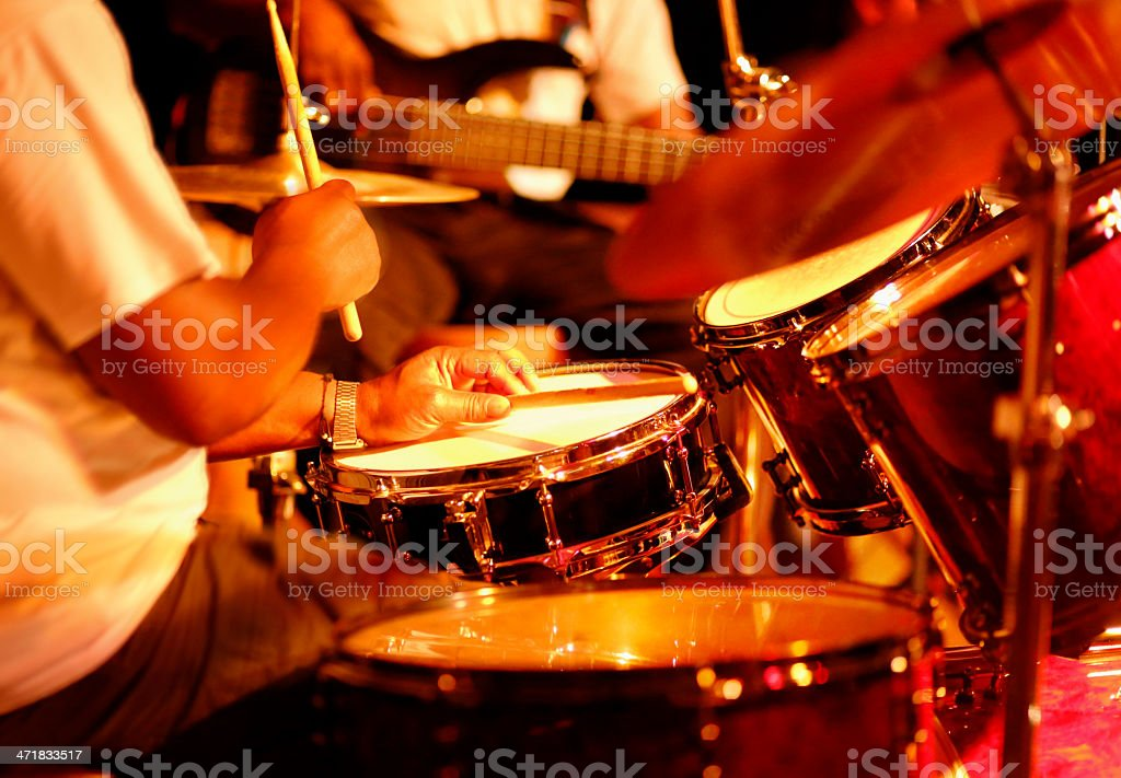 Drummer playing on stage stock photo