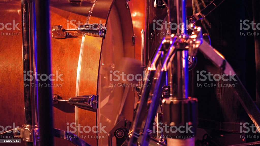 Drummer plays on a bass drum with pedal stock photo