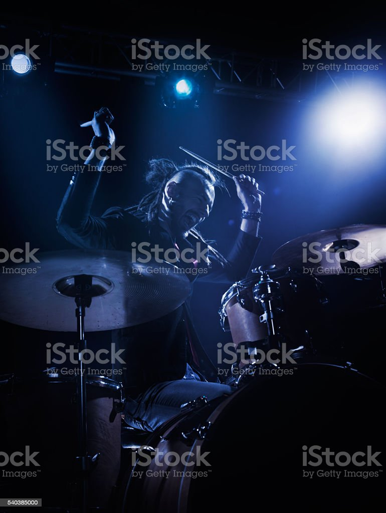 Drummer plays solo stock photo