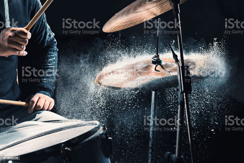 Drummer rehearsing on drums before rock concert. Man recording music on drum set in studio stock photo