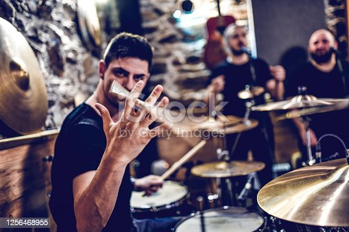 Drummer Showing Stick Spinning Tricks While Recording With Band