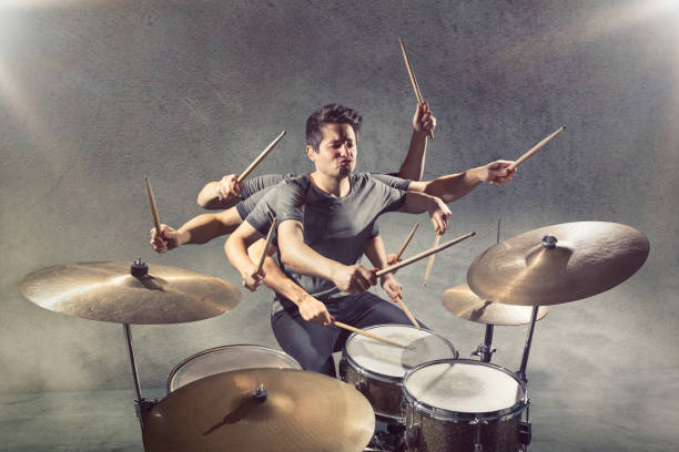 Drummer with many arms A drummer with many arms and a funny facial expression playing his instrument. drummer stock pictures, royalty-free photos & images