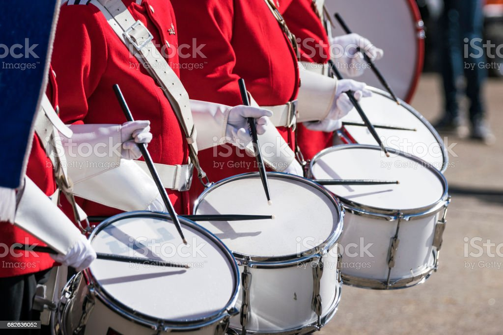 Drummers in red uniforms on a row stock photo