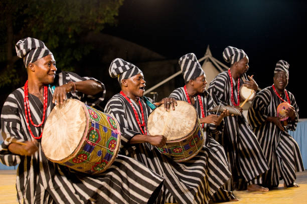drummers of benin traditional dance company - african culture stock photos and pictures