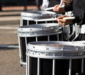 Close up of drummers in a marching band.