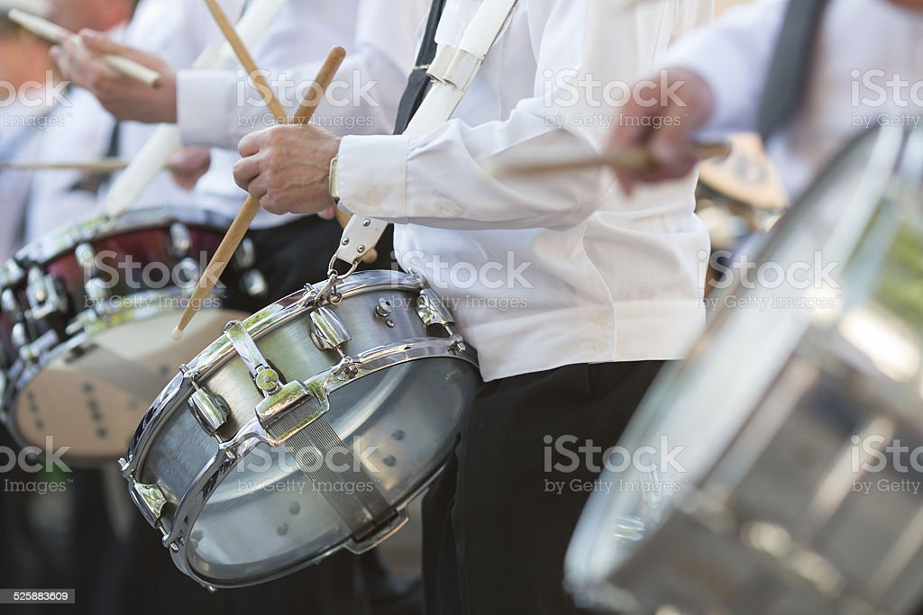 Drummers playing snare drums in parade stock photo