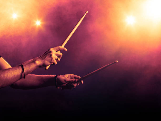 Drumsticks in a hand. Drummer rock concept two male hands holding drumsticks drummer stock pictures, royalty-free photos & images