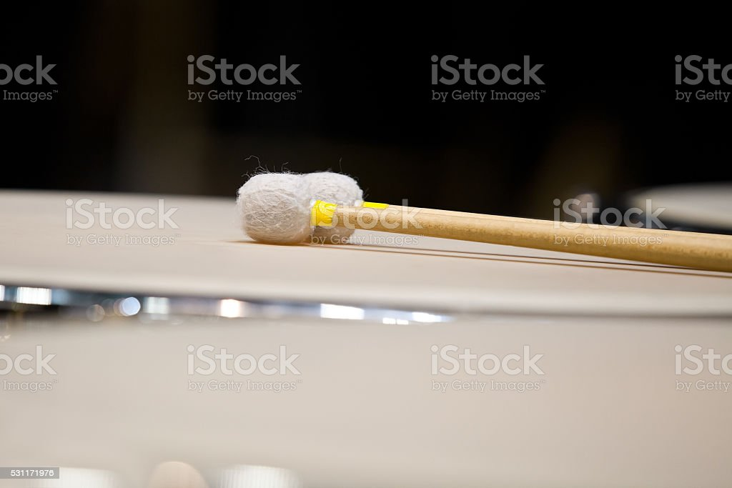 Drumsticks lying on timpani stock photo