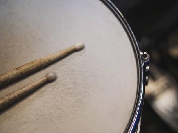 Drumsticks on a black background. Beautiful drumsticks stock photo