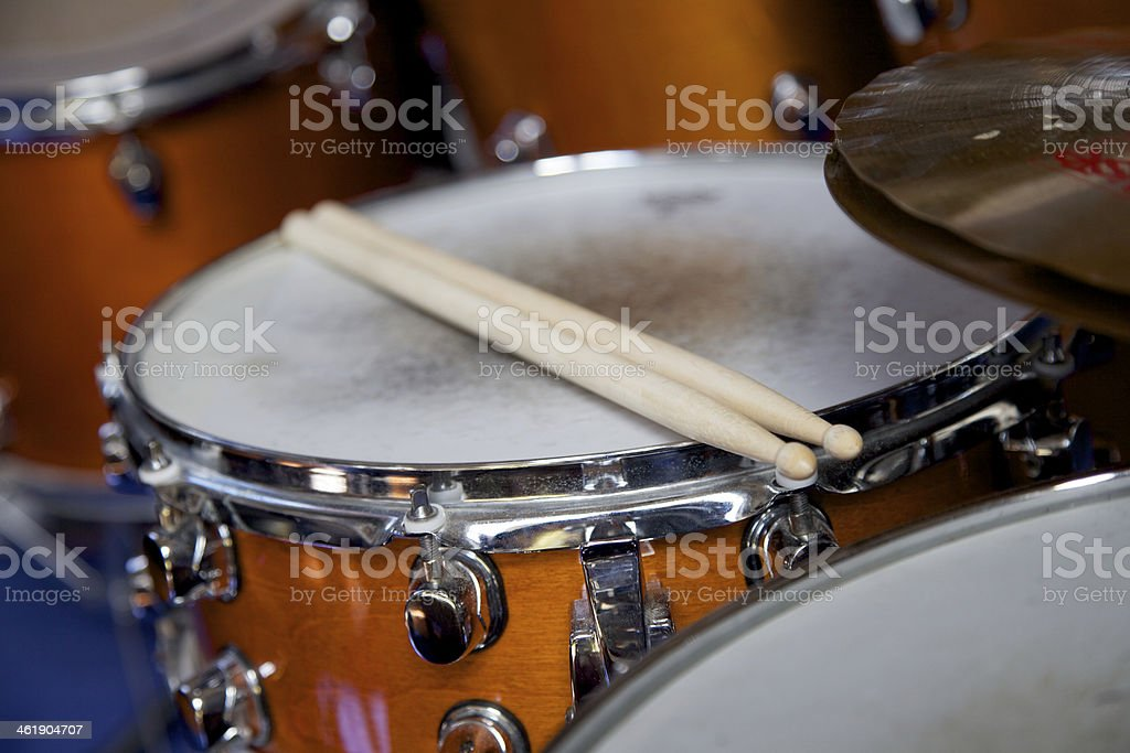 Drumsticks on a snare drum stock photo