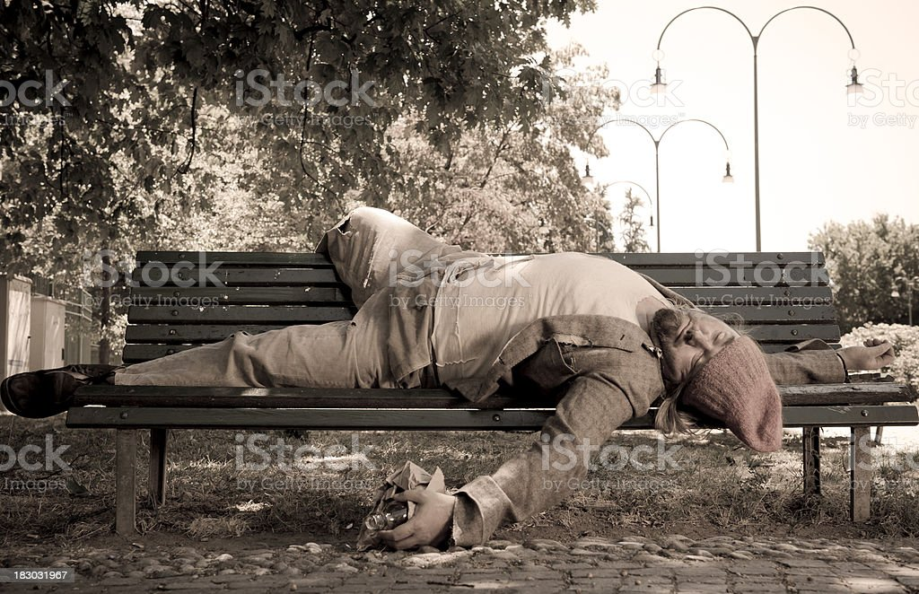 Drunk bum on park bench royalty-free stock photo
