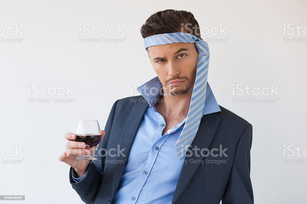 Drunk Business Man with Tie on Head and Glass stock photo