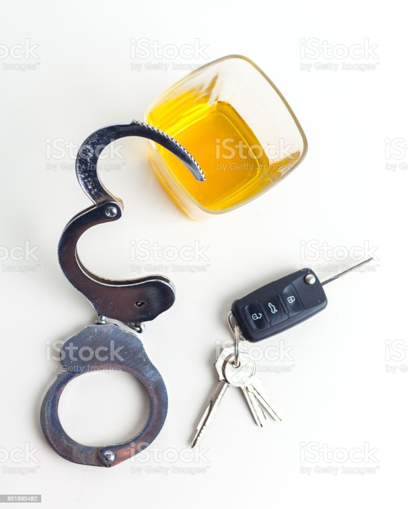 Drunk Driving Concept - Beer, Keys and Handcuffs stock photo
