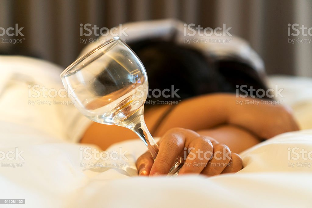 drunk girl sleeping on bed stock photo
