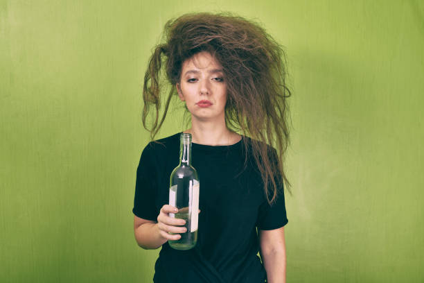 drunk girl with a bottle - drunk stock photos and pictures