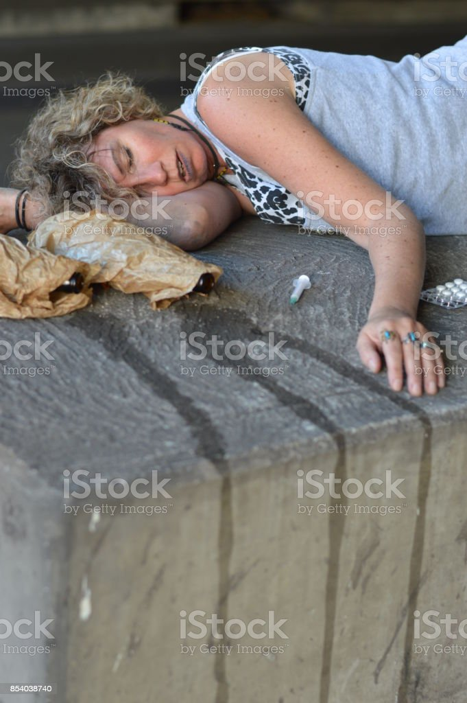 drunk, homeless woman sleeping royalty-free stock photo