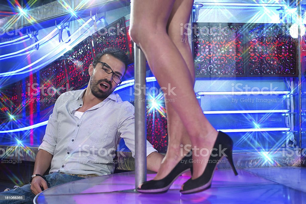 Drunk Man at the Foot of a Lap Dancer stock photo