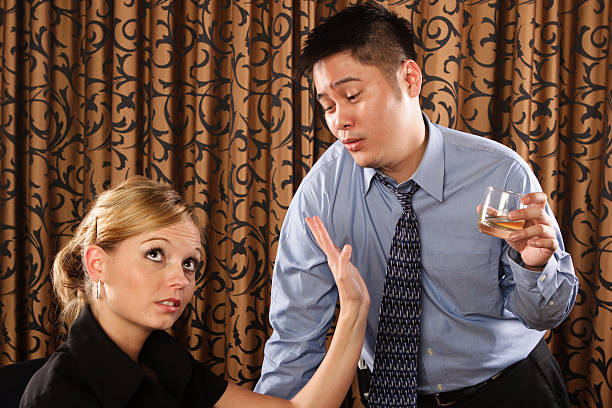 Drunk man comes on to a woman stock photo