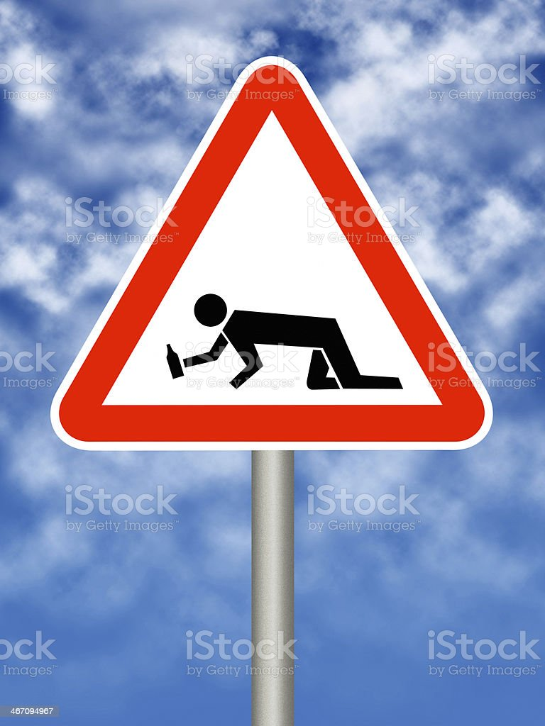 drunk man crossing warning sign stock photo