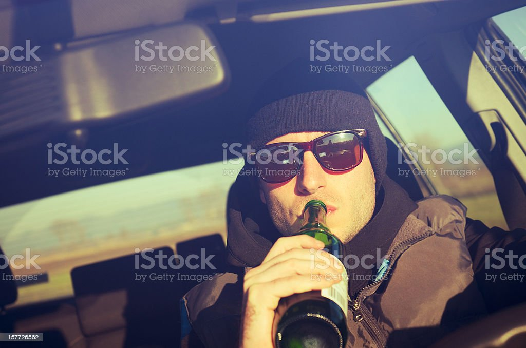 Drunk man driving stock photo