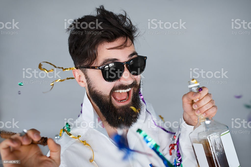 drunk man having fun at wild party stock photo