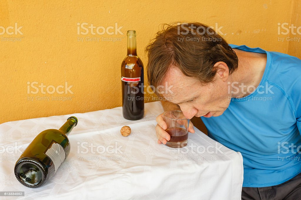 drunk man shumped  on the table stock photo
