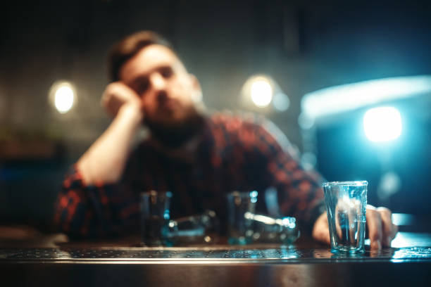 drunk man sleeps at bar counter, alcohol addiction - dipsomania stock pictures, royalty-free photos & images