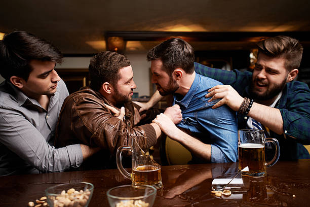 drunk men fighting in pub, their friends trying to - fighting stock photos and pictures