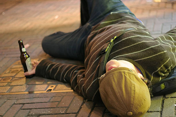 drunk on sidewalk - drunk stock photos and pictures