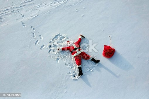 Drunk santa claus lying on the snow drone shot