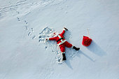 Drunk santa claus lying on the snow