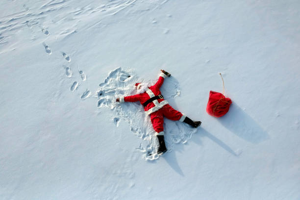 Drunk santa claus lying on the snow stock photo