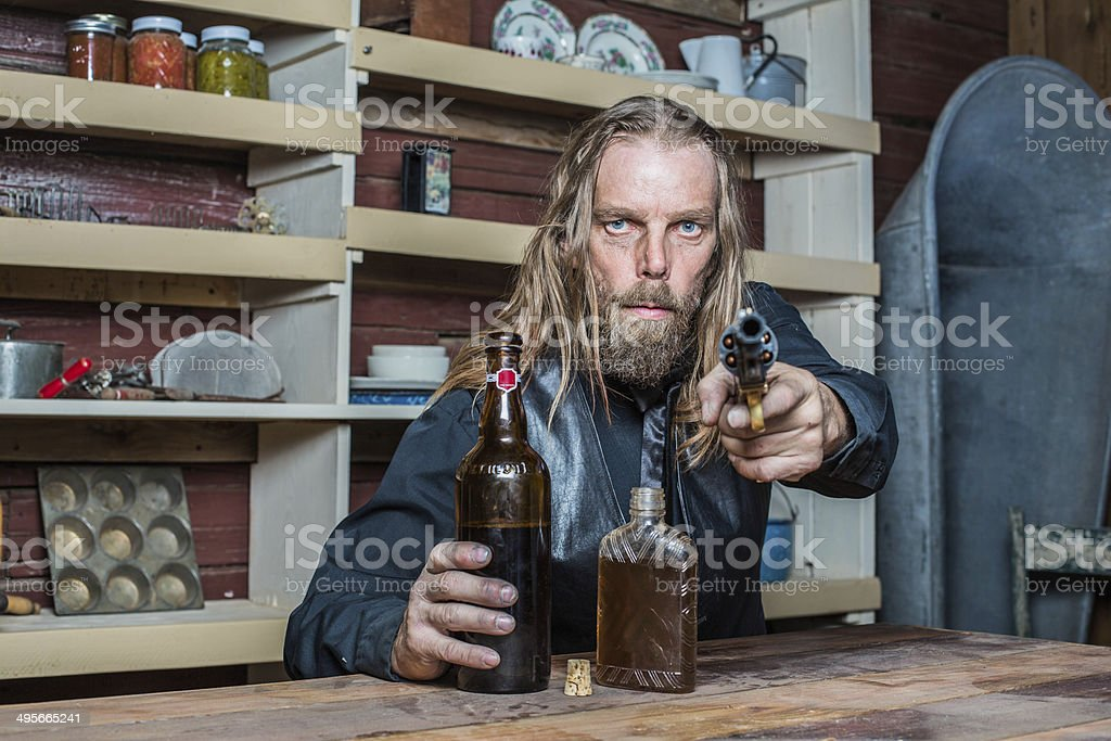 Drunk Western Man at Table stock photo