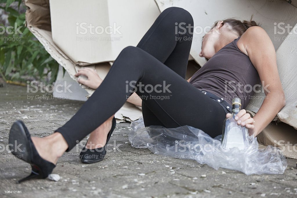 drunk woman sleeping in cartons stock photo