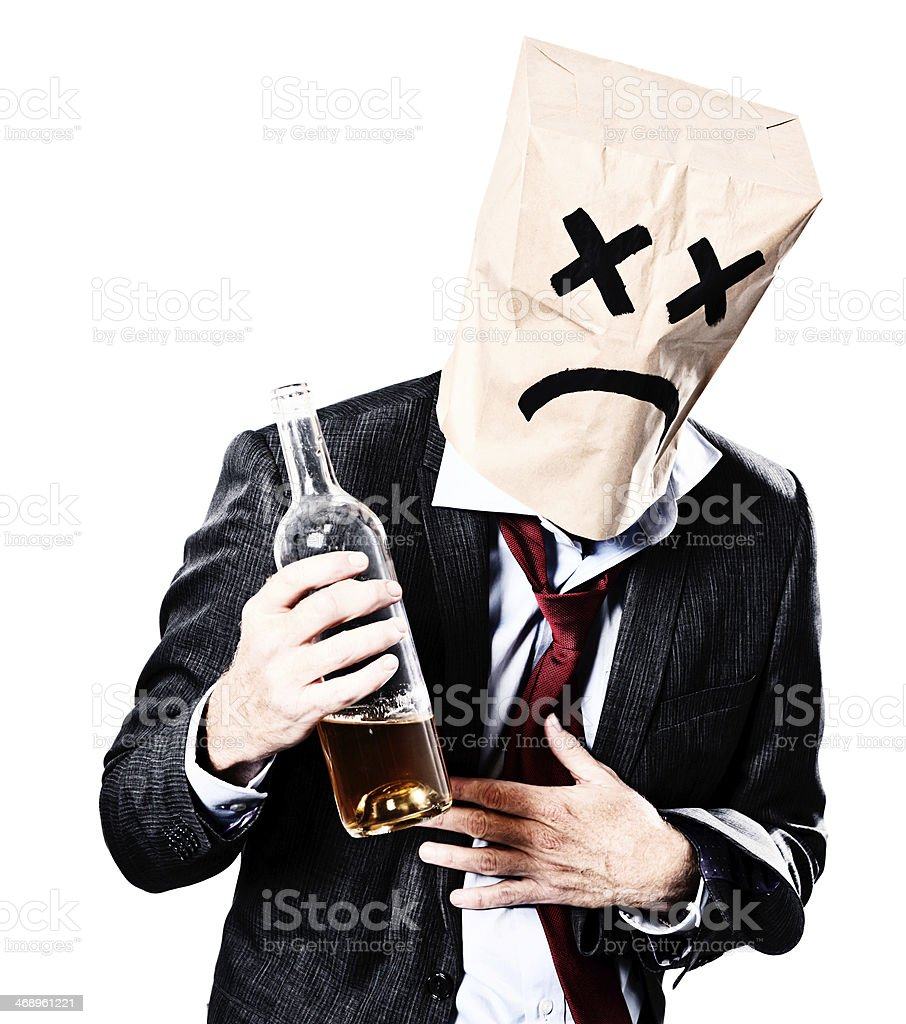 Drunken businessman in paper-bag mask regrets his actions stok fotoğrafı