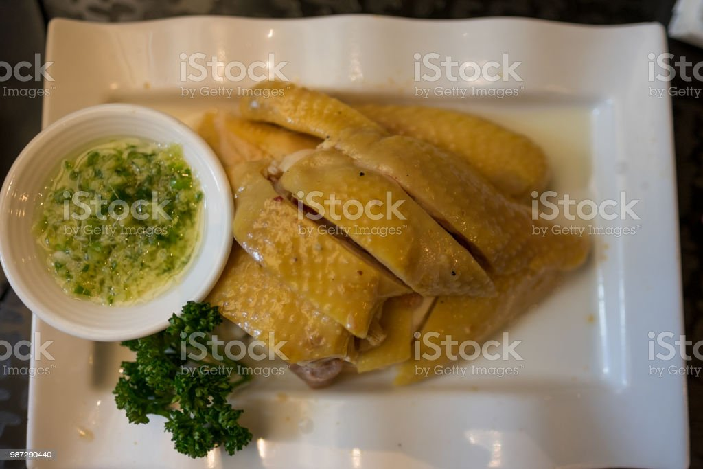 Drunken Chicken - asian food - chinese food - cold dish - with salty garlic garnishMan with rubber glove shucking an oyster stock photo