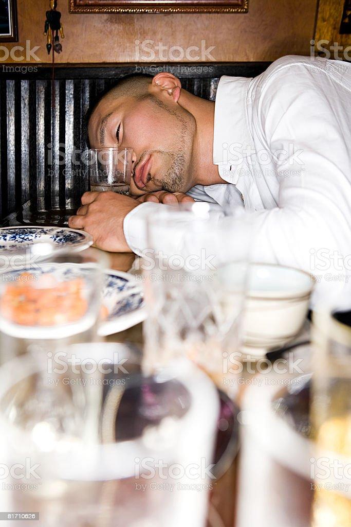 Drunken japanese man sleeping royalty-free stock photo