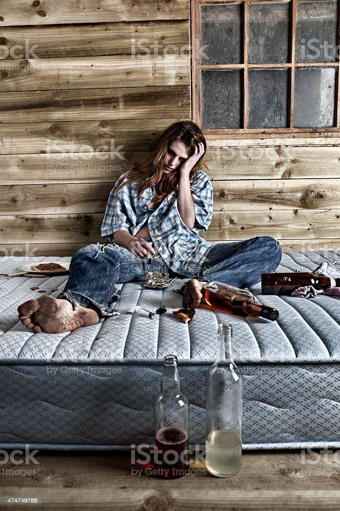 Drunken Junkie Comatose On A Dirty Mattress stock photo